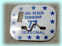 "1977 ""Punched"" Beach Badge"